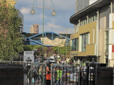 Foreground shows some of the security barriers including turnstyle entry on left