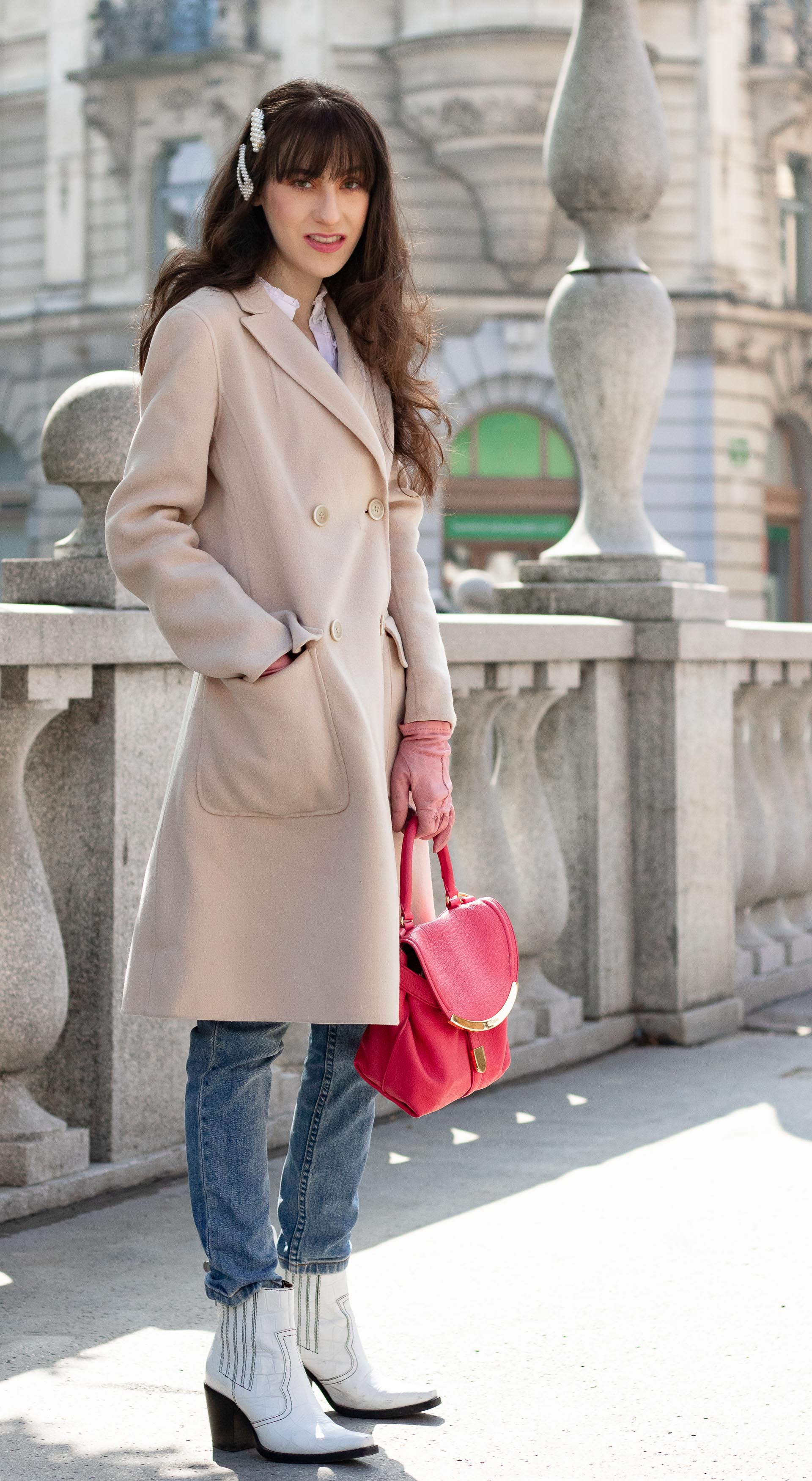 Must follow Slovenian Fashion Blogger Veronika Lipar of Brunette from Wall Street wearing white western Ganni boots Weekend Max Mara coat white fringe shirt a.p.c. washed denim jeans pearl hair accessories See by Chloe pink top handle bag pink gloves on the street