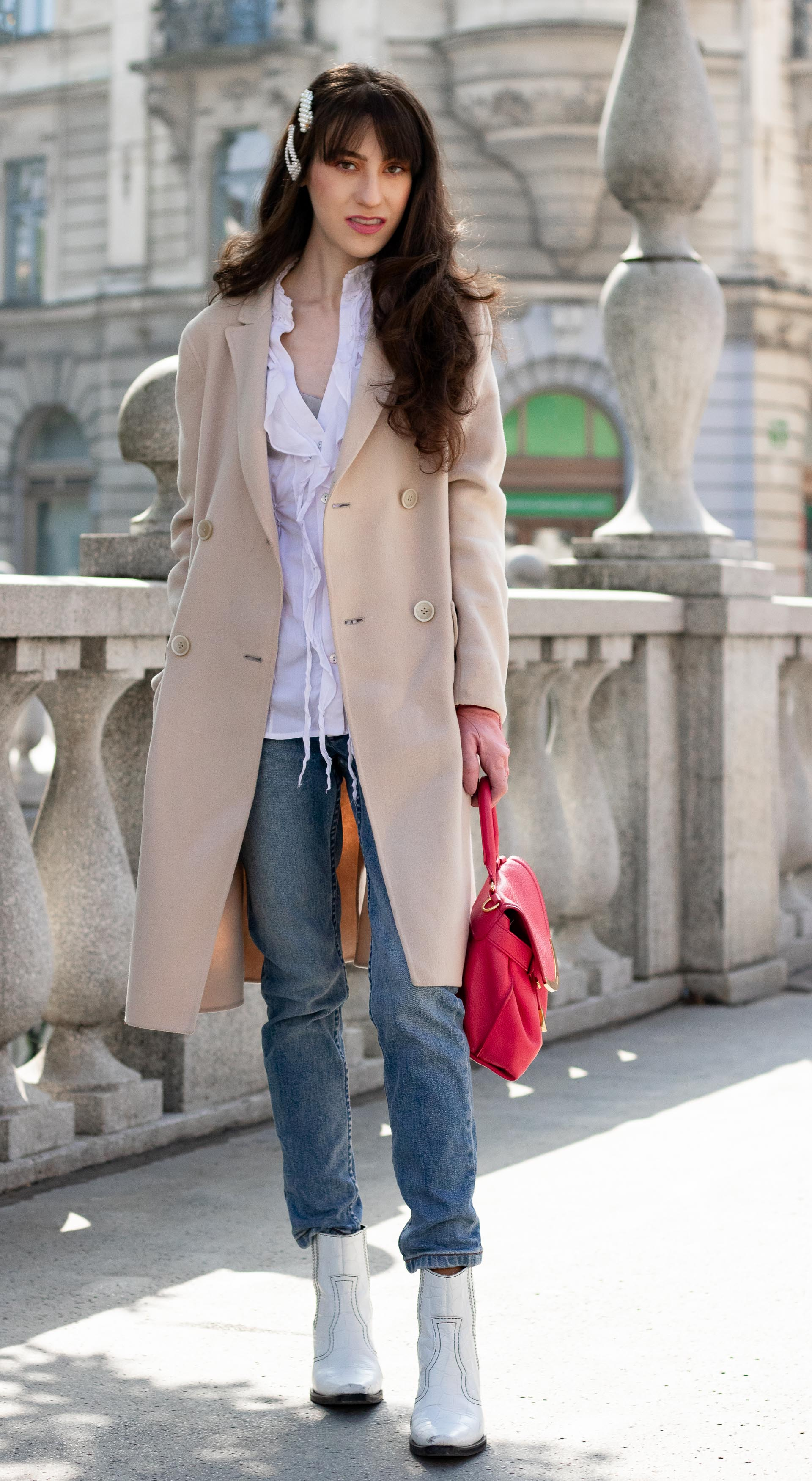 Must follow Slovenian Fashion Blogger Veronika Lipar of Brunette from Wall Street dressed in white western Ganni boots Weekend Max Mara coat white fringe shirt a.p.c. washed denim jeans pearl hair accessories See by Chloe pink top handle bag pink gloves on the Triple bridge