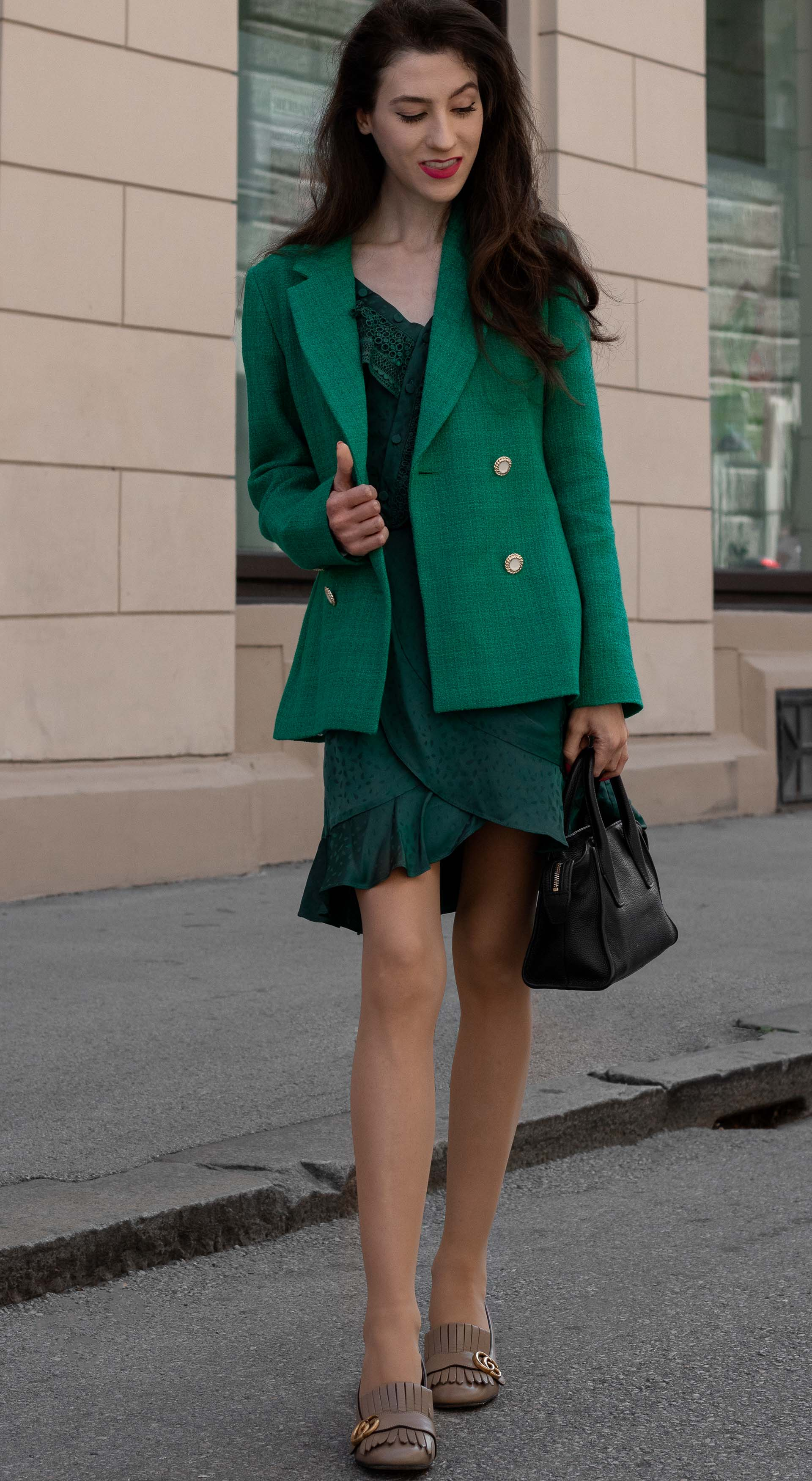 Fashion blogger Veronika Lipar of Brunette from Wall Street dressed in Sandro Paris double breasted green blazer self-portrait wrap dress Gucci heeled loafers black bag for work in fall