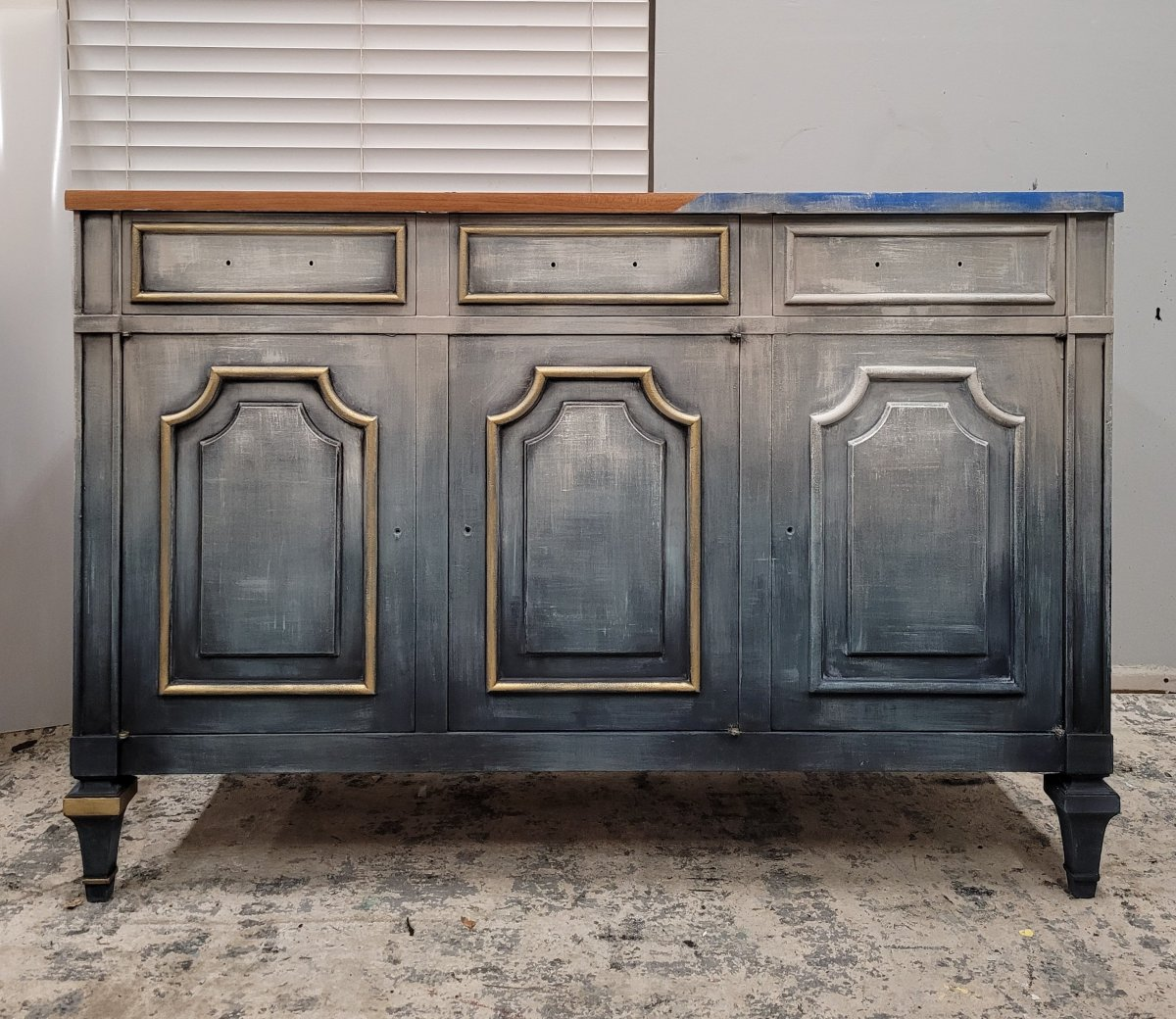adding black and gold wax details to the faded blue jean painted furniture finish