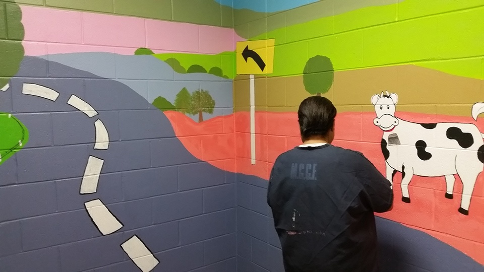 Mural BWTL painted inside of MCCF Female visitation room area for children to visit with their incarcerated loved one. Female inmates helped draw and paint this mural.