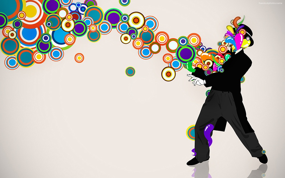 guy in tuxedo throwing circle shapes