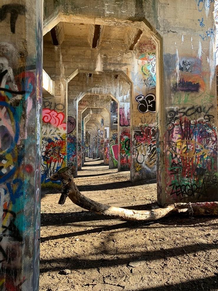 graffitied under bridge