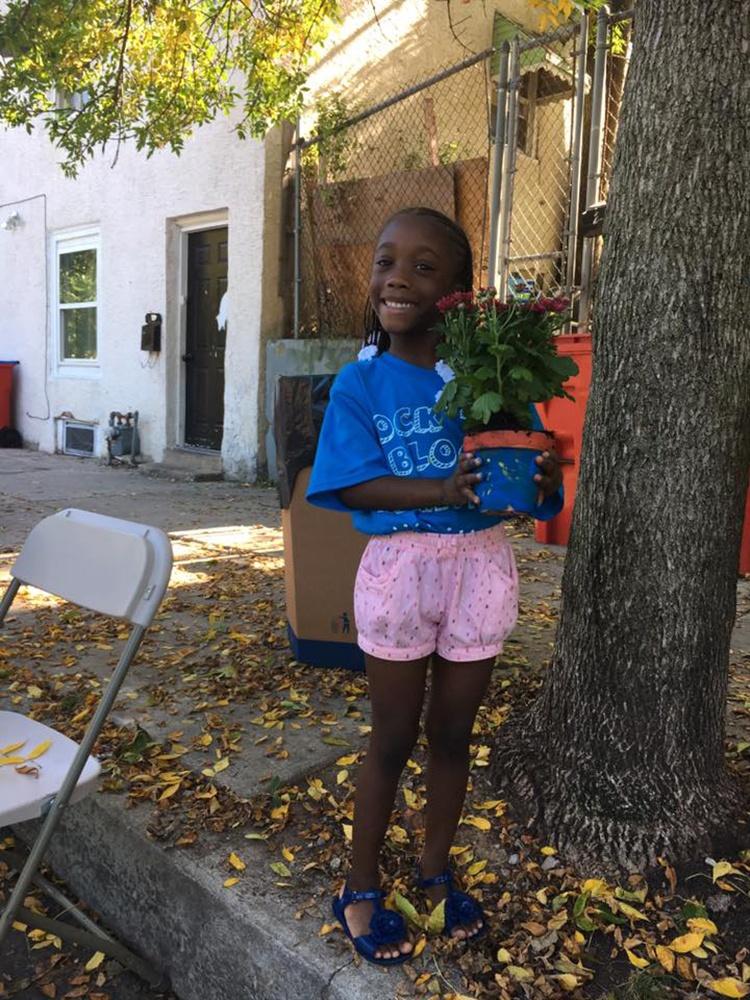 Rock the Block little girl holdinga flower pot