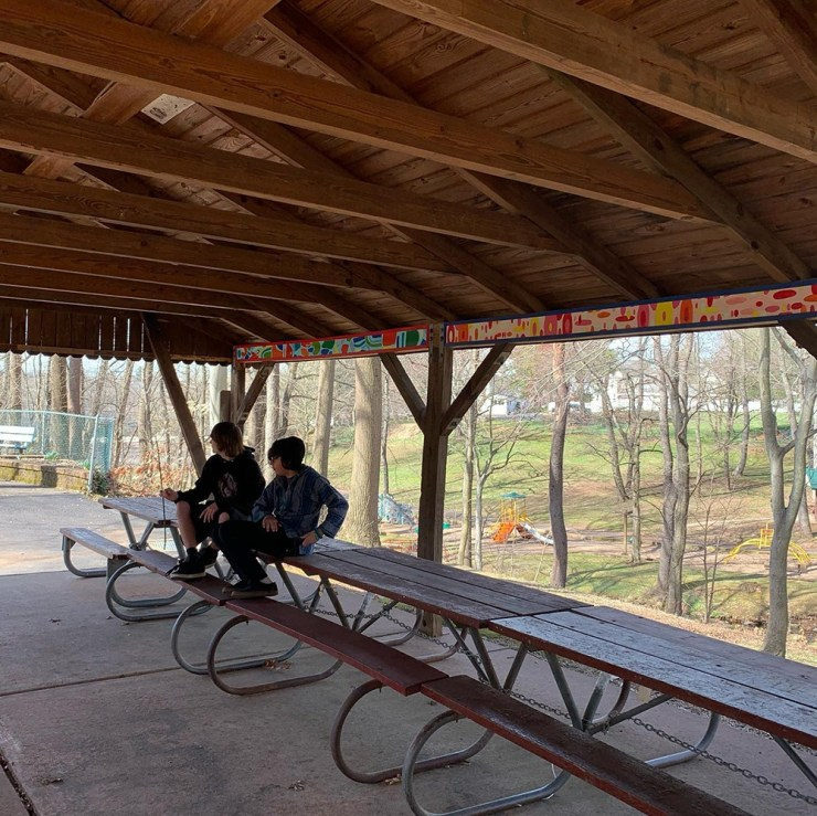 Residents of the park enjoying the newly painted pavilion