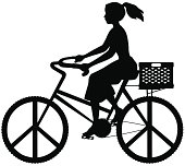 Girl on bicycle with peace symbol wheels