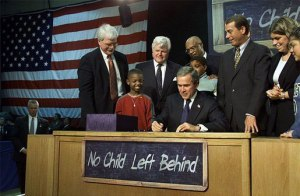 Signing into law No Child Left Behind.