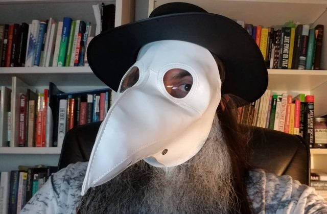 Bryan with plague doctor mask in office
