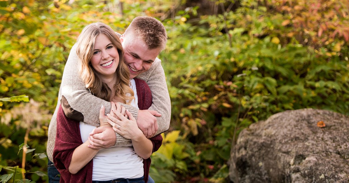 Engagement couple photo in fall colors.