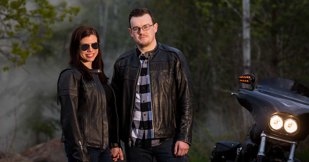 Motorcycle engagement photos, happy couple wearing shades.