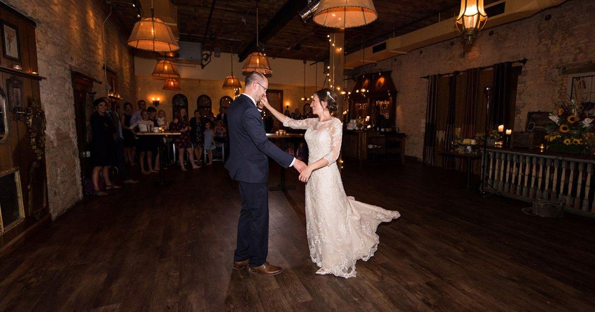 Bride and groom portrait dancing on wedding day.