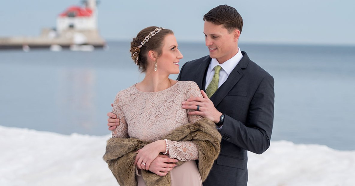 Winter wedding photo of a bride and groom in Canal Park - Duluth, MN.