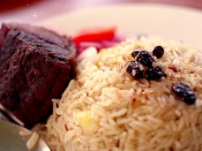 Pilau, a spiced rice, served with fried fish.