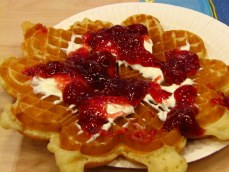 Norwegian waffle with cream and jam.
