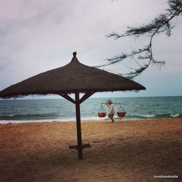 phu quoc beach fruit lady umbrella beach scene vietnam