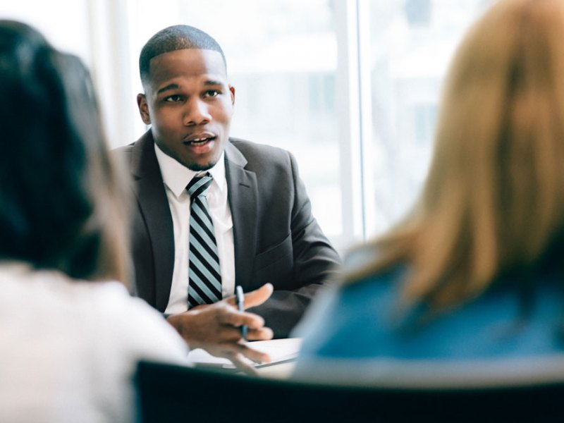 Consultant sitting with potential clients