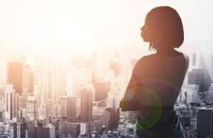 Black-Woman-Window-City-for-Web Woman at Window