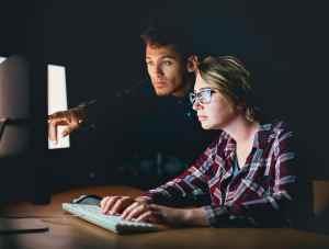 Man pointing at computer screen