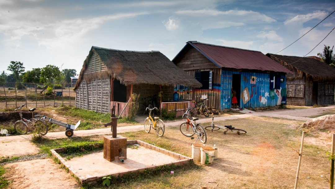 Students bikes are parked around the well on the CESHEO Svay Thom campus near Siem Reap, Cambodia
