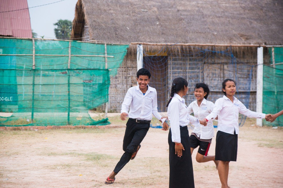 Students play a game on the playground on the CESHEO Svay Thom campus near Siem Reap, Cambodia