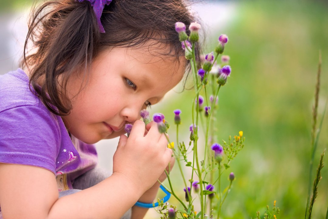 Chinese girl touching flowers