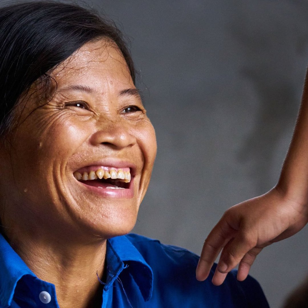 Vietnamese woman laughing.