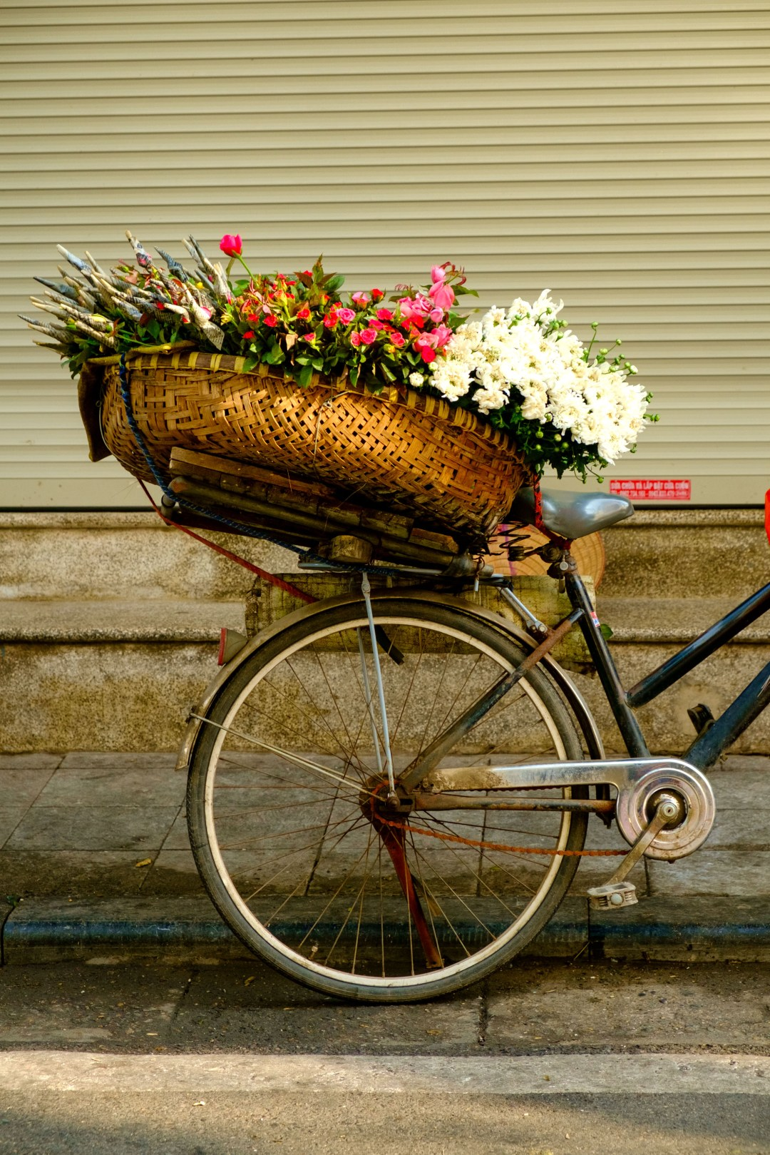 Flowers in a basket on a bicycle - Old French Quarter, Hanoi, Vietnam