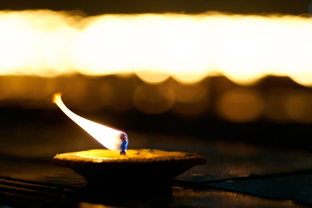 Photo of small candles burning during the Loi Krathong festival in Chiang Mai, Thailand  on November 11, 2019 by photographer Bryon Lippincott