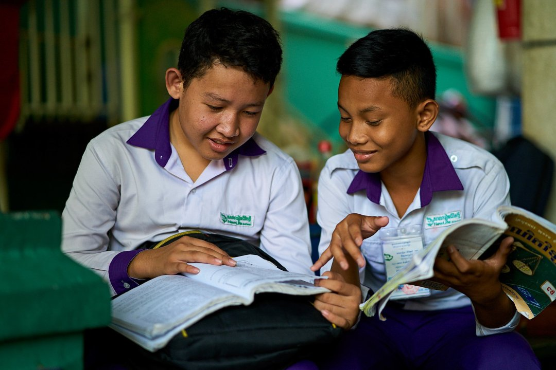 Photo of two male students studying for class at New Life School in Phnom Penh, Cambodia.