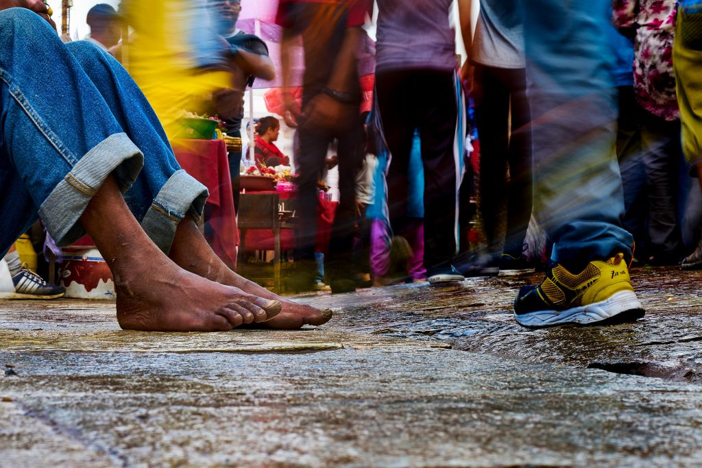 "Photo of a man feets who was begging at Swayambhunath Stupa in Kathmandu, Nepal by Humanitiarian Photographer, Bryon Lippincott. This man would be considered ""the least of these"" in Christian circles."