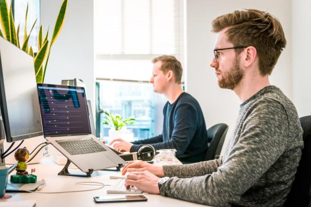 Developers coding with Ruby on Rails