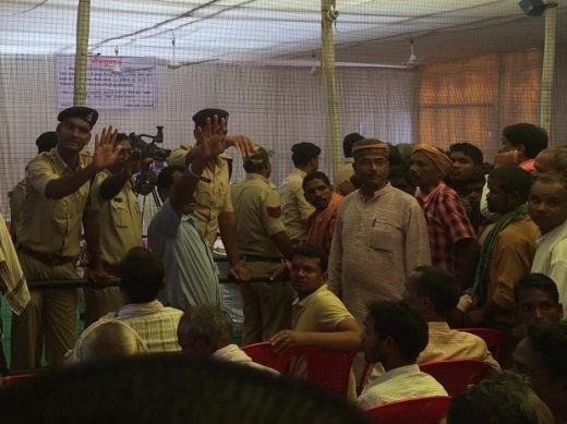 Police officials pacifying the protesters during the public meeting (Image courtesy: R Krishna Das)