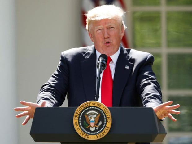 US President Donald Trump announces his decision that the United States will withdraw from the Paris Climate Agreement, in the Rose Garden of the White House in Washington
