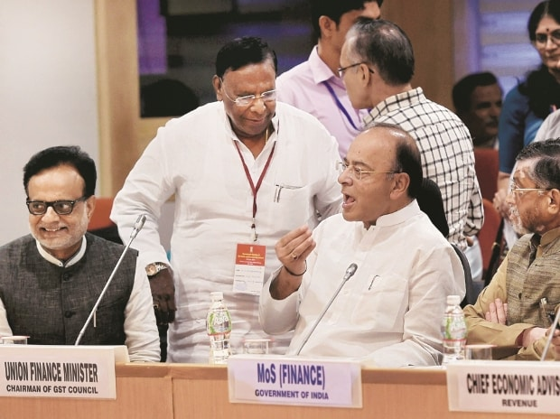 (From right) Union Finance Minister Arun Jaitley with Puducherry Chief Minister  V Narayanasamy and Revenue Secretary Hasmukh Adhia at the17th GST Council meet at Vigyan Bhavan in New Delhi on Sunday	 Photo: pti