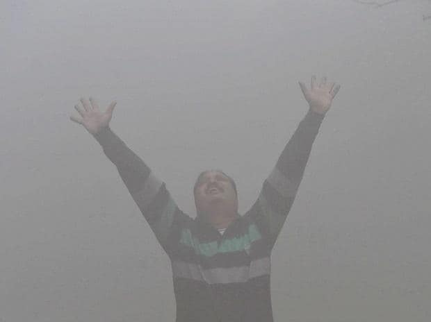 Braving the pollution, a person seen doing yoga at a public park in New Delhi