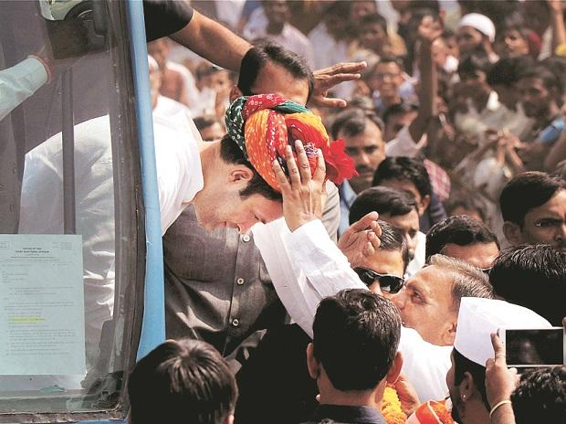 Congress Vice-President Rahul Gandhi being presented a turban by supporters  during a roadshow at Banaskantha in Gujarat on Sunday 	Photo: PTI