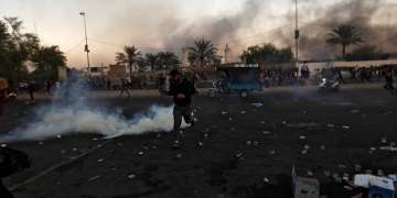 Two Iraq suicide bombers kill 11 fighters loyal to Shiite cleric Sadr