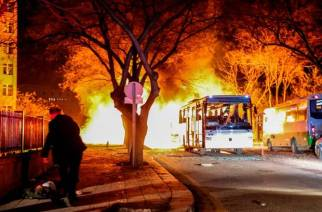 Turkish army service busses burn after an explosion on February 17, 2016 in Ankara, Turkey. 21 people are believed to have been killed and at least 61 are said to be wounded according to the city's governor Mehmet Kiliclar in what appeared to have been a car bomb attack on a vehicle carrying military personnel in the Turkish capital. (Photo by Defne Karadeniz/Getty Images)