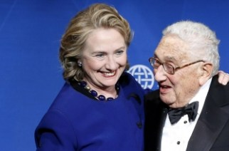 Hillary Clinton smiles as Henry Kissinger presents her with a Distinguished Leadership Award from the Atlantic Council in Washington in May 2013.