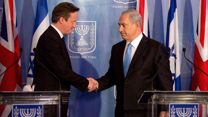 British Prime Minister David Cameron shakes hands with his Israeli counterpart and fellow war criminal Benjamin Netanyahu