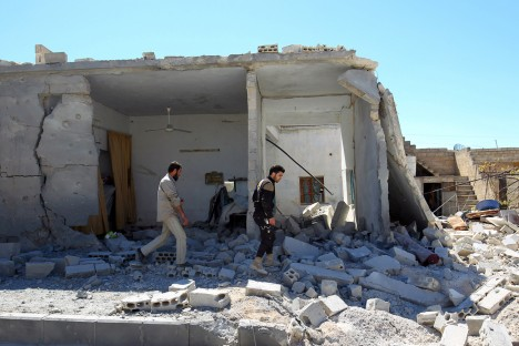 White Helmets operatives inspect the damage at a site hit by airstrikes, in the town of Khan Sheikhoun in rebel-held Idlib, Syria, April 5, 2017. Source: Reuters