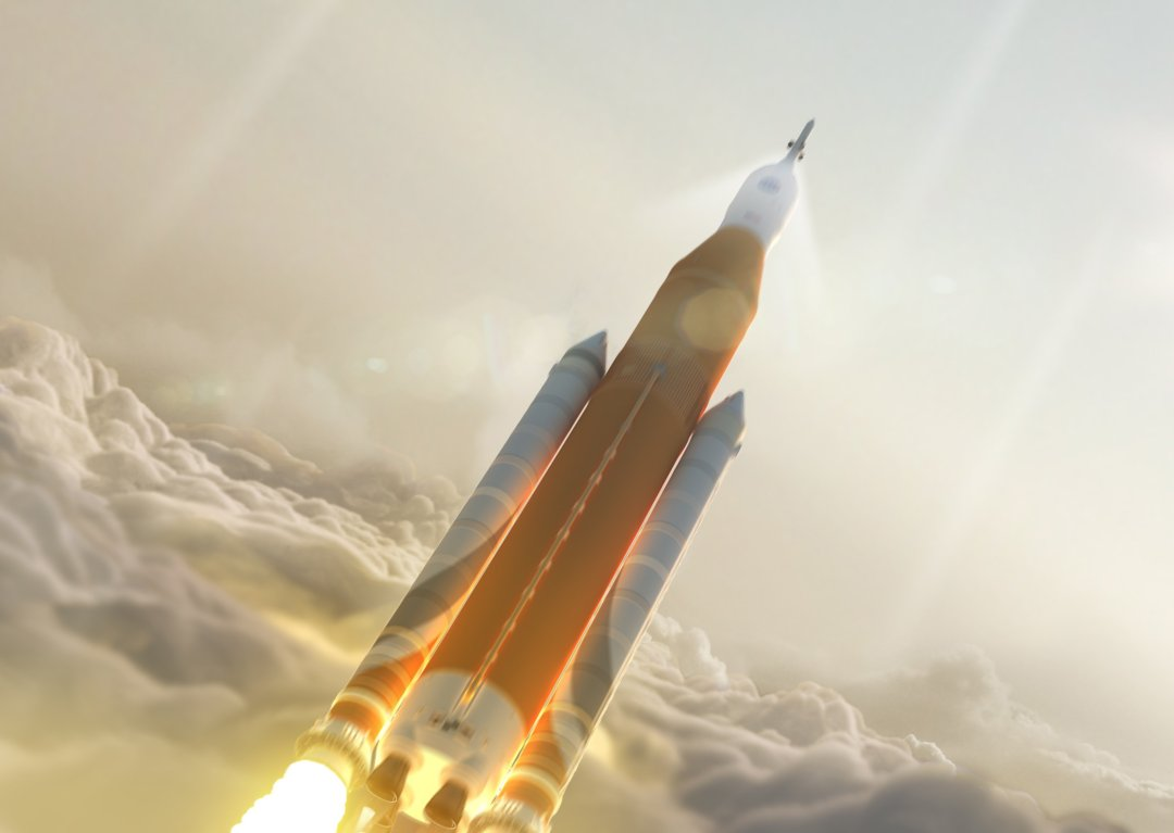 Orange_tank_SLS_launch_through_clouds_-_Post_CDR