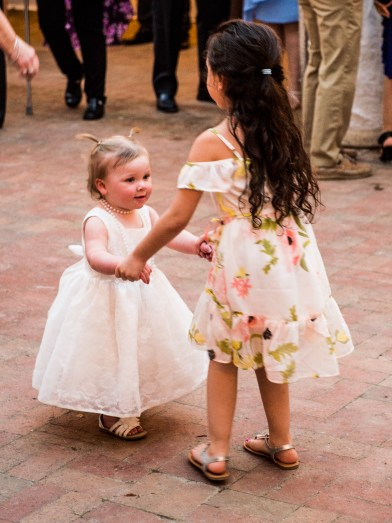 The petal princess (aka bride's niece) is good at getting people to dance with her.