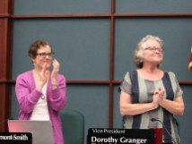 Isabel Piedmont-Smith and Dorothy Granger give Lee Huss a round of applause. (Dave Askins/Beacon)