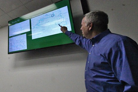 BT general manager Lew May explains BT staff recommendations for adjustments to the optimization-study recommended new routes. (Dave Askins/Square Beacon)