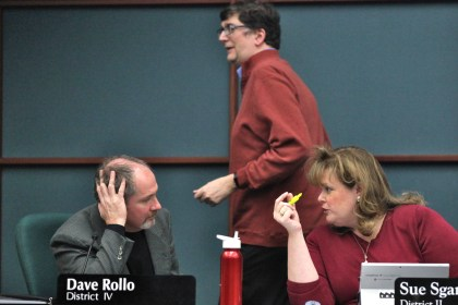 Dave Rollo talks with Sue Sgambelluri before the start of the Jan. 29, 2020 city council meeting.