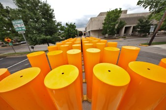 Bollards for Kirkwood street closures stored on Lincoln Street across from the Monroe County public library.