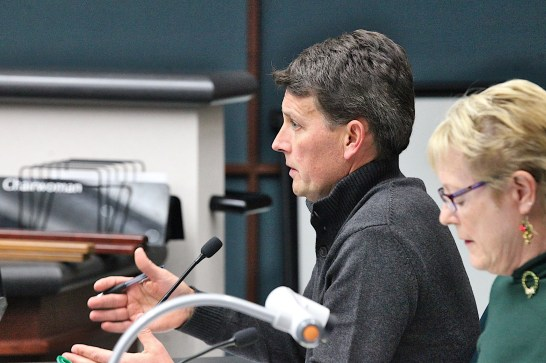 On Monday night, Scott Robinson was confirmed by the city plan commission as director of Bloomington's planning and transportation department. This Square Beacon file photo shows Robinson at a Bloomington city council meeting in late 2019. To Robinsonson's left is then-director of planning Terri Porter.