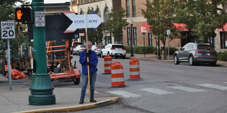 Around 8:15 a.m. on Oct. 6, 2020, Ed Robertson stood at the corner of 7th and Walnut in Bloomington, Indiana directing voters to Election Central.